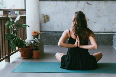 women sitting doing yoga